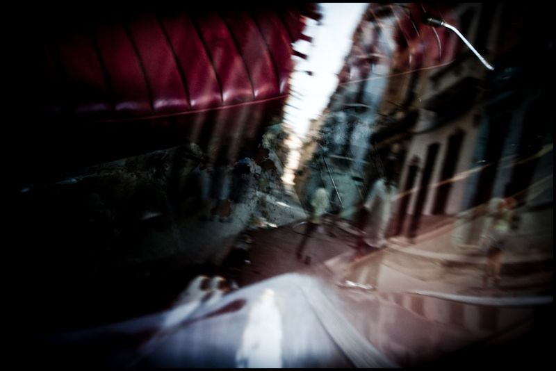 Zoriah_photojournalist_war_photographer_cuba_reflected_reflection_window_windshield_puddle_20090809_0520