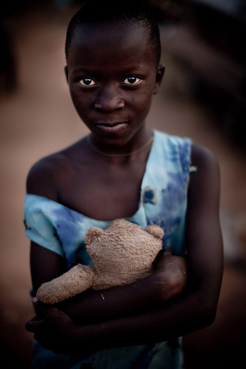 0001_uganda girl with teddy bear 3_20110217_0101