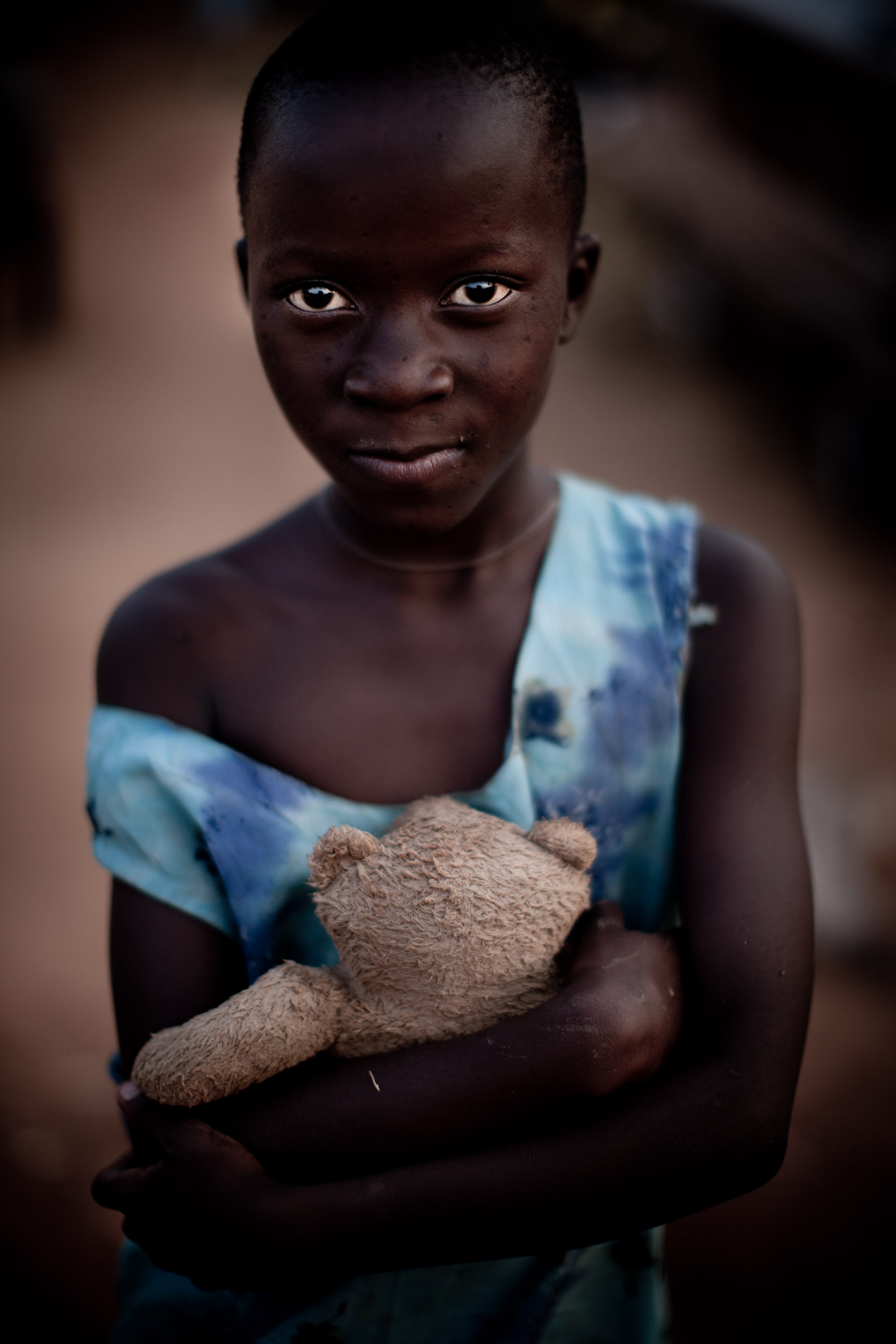 0001_uganda girl with teddy bear 3_20110217_0101